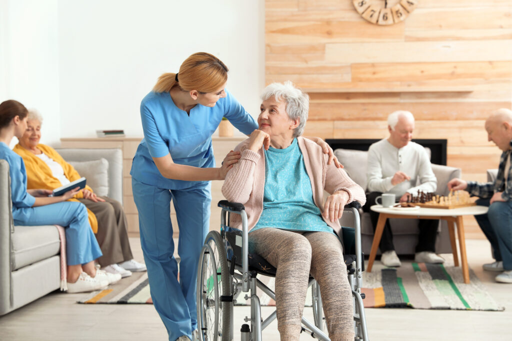 Nurses assisting elderly people at a retirement home